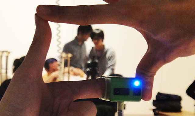Ubi-Camera - Vise et zoom avec les doigts