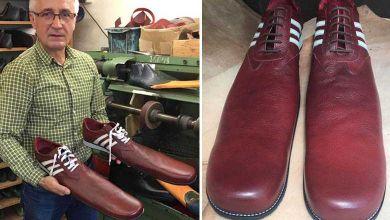 Photo de Un cordonnier roumain fabrique des chaussures anti-COVID taille 75 pour faire respecter la distanciation sociale